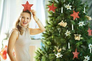 cheerful woman playing with Christma