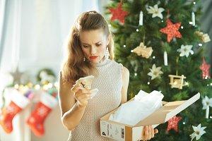woman near Christmas tree looking at