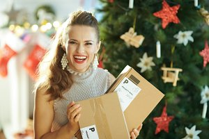 smiling young woman with parcels nea