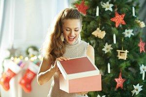 happy housewife near Christmas tree