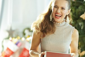 smiling young woman with Christmas g
