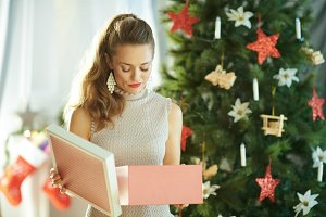 unhappy woman with opened Christmas