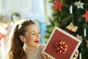 smiling woman near Christmas tree lo