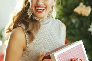 housewife with Christmas gift lookin