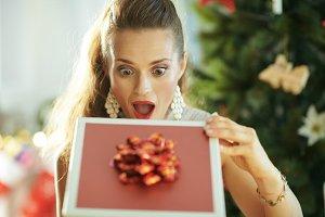 housewife near Christmas tree lookin