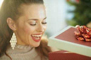 happy woman near Christmas tree look