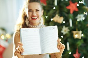 Closeup on happy woman showing diary