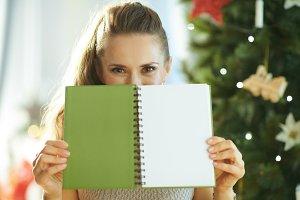 modern woman hiding behind green not