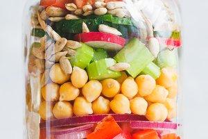 Single jar with layering vegan salad
