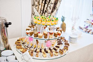 Wedding reception, table of cakes an