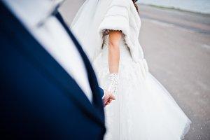 Hand in hand of wedding couple