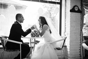 Wedding couple sitting at a table in