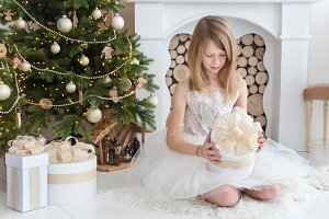 Girl opening Christmas gifts