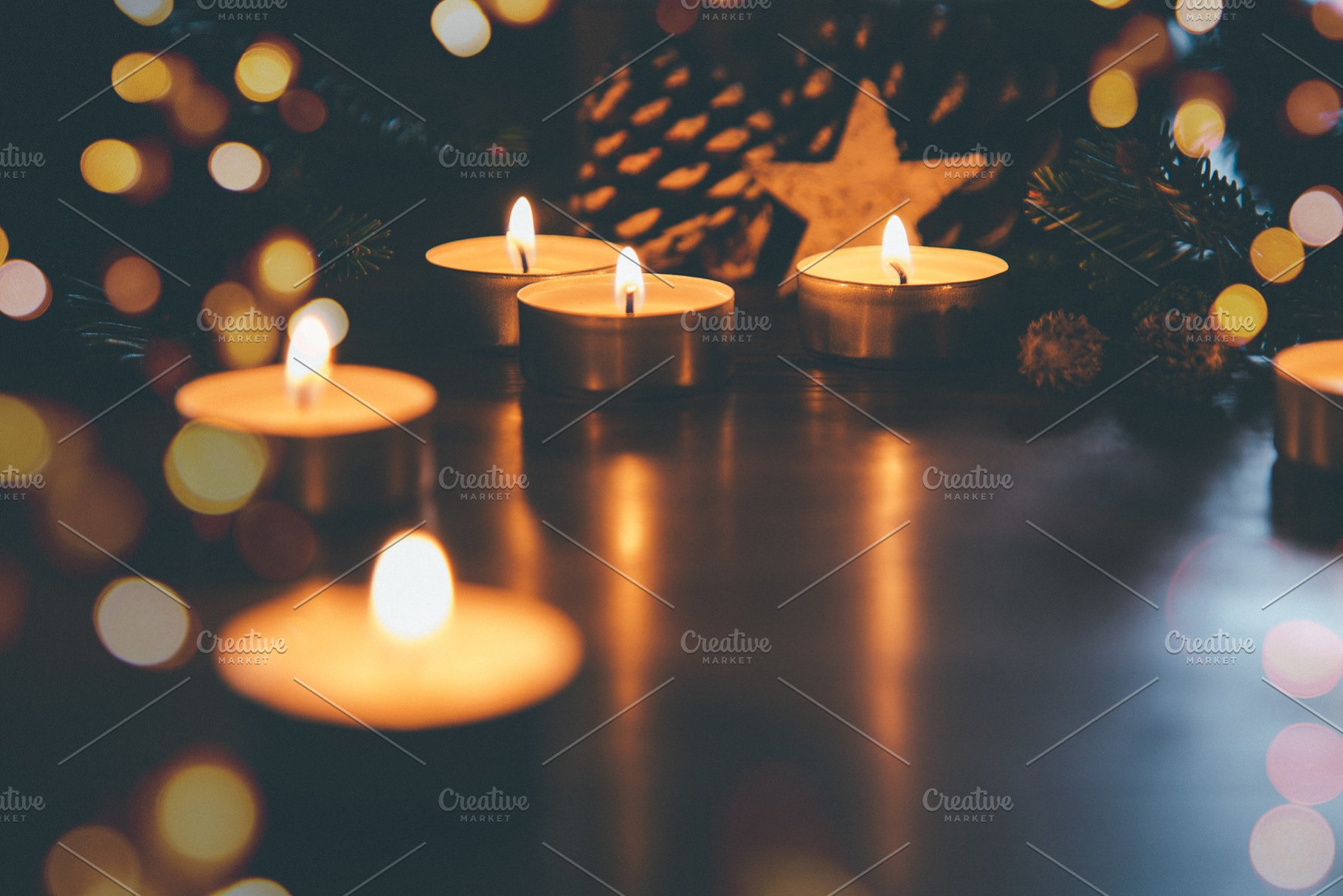 Christmas candles with ornaments and