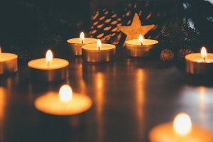 Christmas candles with ornaments in