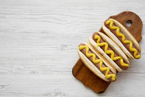 Hot dog with yellow mustard