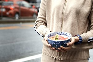 Woman holding sashimi in japan