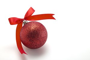Red Christmas ball with ribbon bow