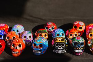 Ceramic skull, small colorful heads