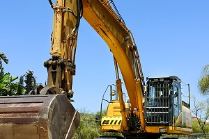 Excavator parked in the sand ready