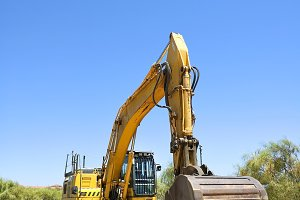 Excavator parked in the sand ready.