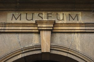 museum sign carved in stone