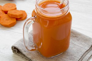 Carrot smoothie in glass jar