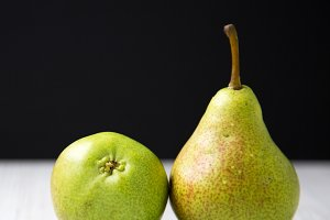 Two tasty pears, side view. Close-up