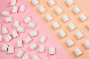 Sweet marshmallows on pastel yellow