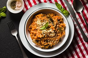 Italian risotto with tomato sauce on