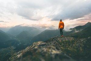 Man adventurer on mountain summit