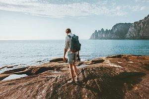 Man traveler walking alone on beach
