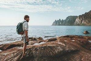 Man backpacker walking alone