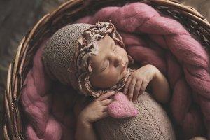 Newborn baby sleeps sweetly heart