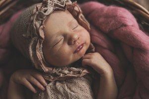 Newborn baby sleeps sweetly