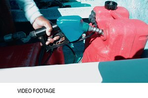 Man fueling tank of a motor boat