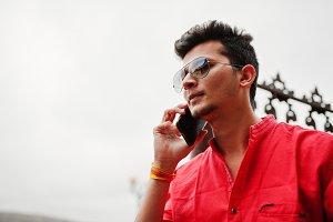 Indian man at red shirt and sunglass
