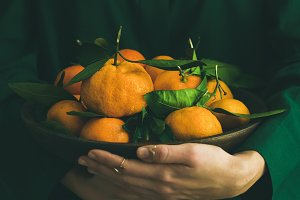 Fresh tangerine fruit with leaves in