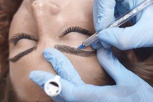 microblading close-up, hands adding