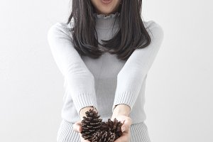 beautiful girl with a Pine cones
