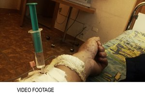 Hand of sick person with syringe