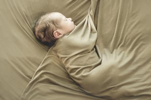 Newborn baby sleeping wrapped