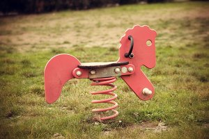 Wooden horse with spring in the play