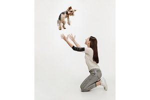 Woman with her dog on leash over