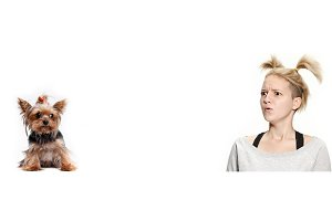 Woman with her dog over white