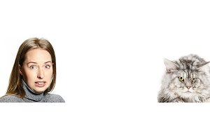 Woman with her cat over white