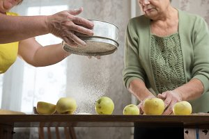 Two elderly woman making apple