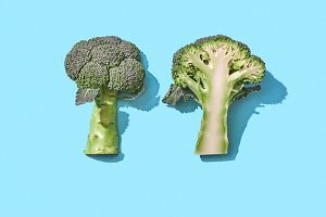 Broccoli on blue background with