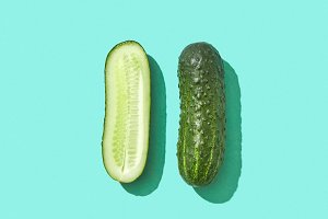 Whole and half organic cucumber on a