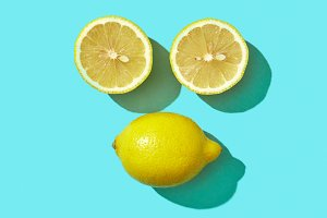 Two halves and a whole ripe lemon in
